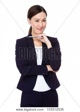 Asian Businesswoman think of idea with a pen