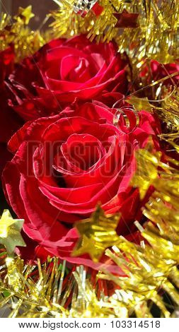 Christmas decoration Red roses and golden garland