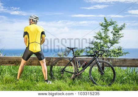 Cyclist Peeing In The Bushes During A Race