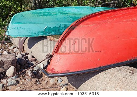 Old Colorful Rowboats Lay On The Coast