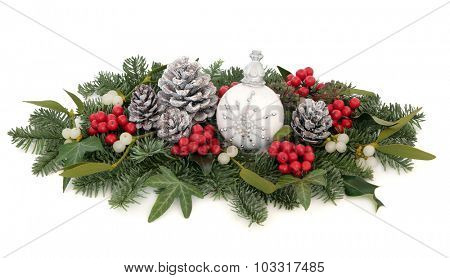 Christmas flora with snowflake bauble, holly, mistletoe, pine cones and traditional greenery over white background.