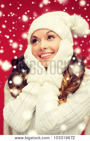 winter, people, happiness concept - woman in hat, scarf and mittens