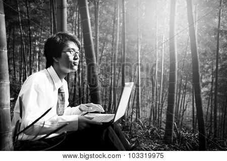 Businessman Outdoor working in the forest Concept