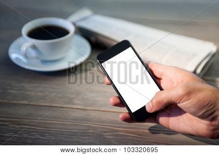 Close up of person using smartphone at the desk