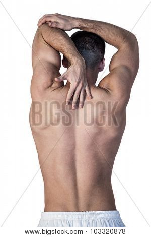 Rear view of shirtless man suffering from back pain over white background