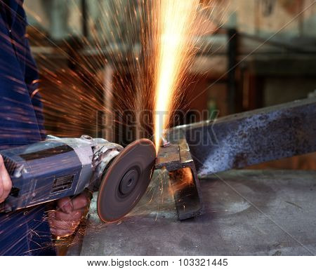 Using an angle grinder.