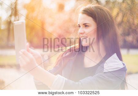 Beautiful Girl With Tablet Or Ebook Outdoor