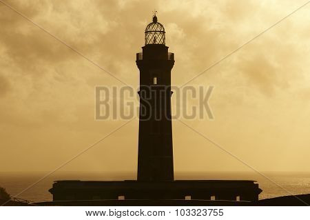 Lighthouse At Sunset In Faial Island. Ponta Dos Capelinhos. Azores