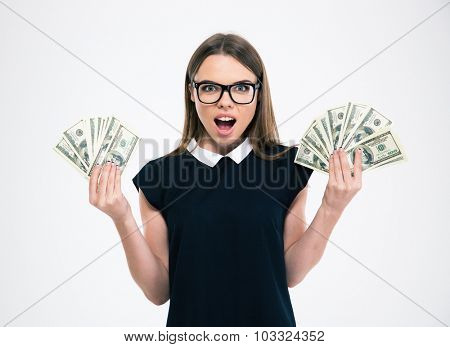 Portrait of a happy girl holding dollar bills isolated on a white background