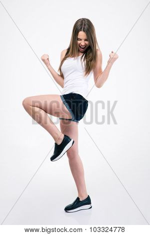 Full length portrait of a casual woman celebrating her success isolated on a white background
