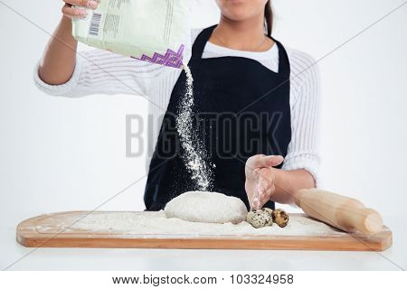 Closeup portrait of a baker preparing dough for pastry isolated on a white background