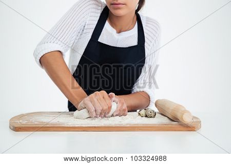 Closeup portrait of a female hands preparing dough for pastry isolated on a white background