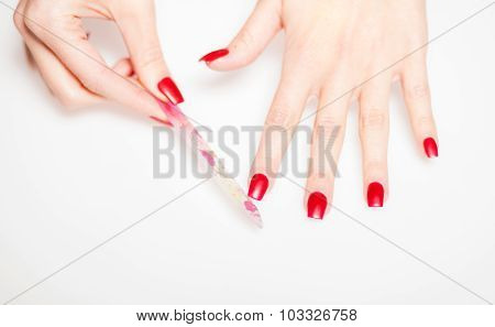 Girl Hand Manicure With Nail File On Bright Background