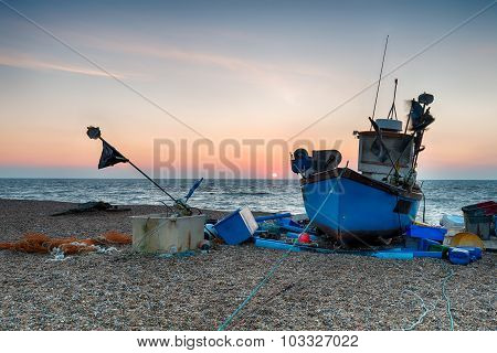 Blue Fishing Boat On A Beach In Suffolk