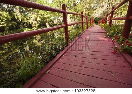 The red bridge in Magnolia Gardens in Charleston is a popular landmark
