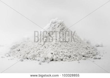 Wheat flour heap on white background, health