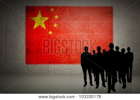 Silhouettes standing against china