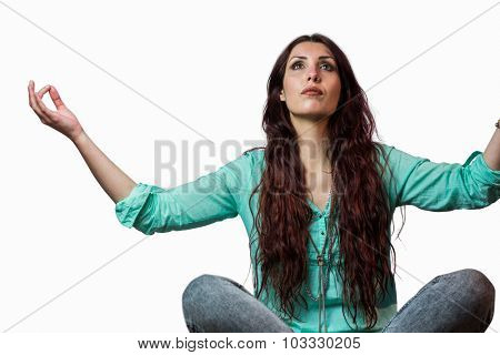 Woman levitating with arms raised against white background