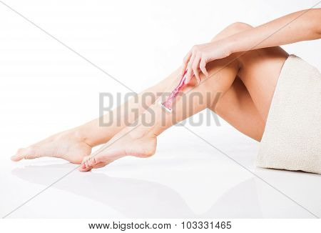 Slim Woman Shaving Legs With Razor