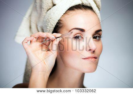 Fresh Model Girl Shaping Eyebrows With Tweezer