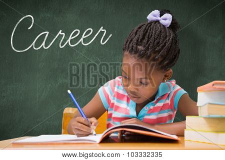 The word career and cute pupils writing at desk in classroom against green chalkboard