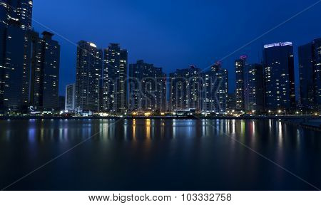 Night view of modern buildings, Haeundae in Busan, South Korea.
