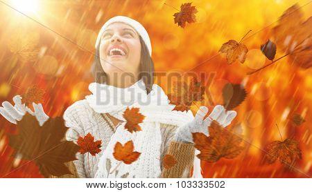 Brunette in warm clothing against autumn scene