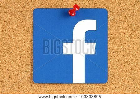 Facebook logo sign printed on paper and pinned on cork bulletin board