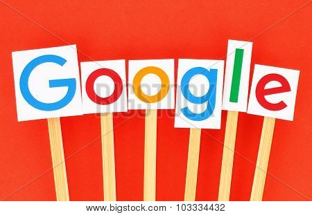 New Google logotype printed on paper cut and pasted
