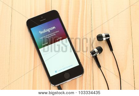 iPhone with Instagram logotype on its screen and headphones