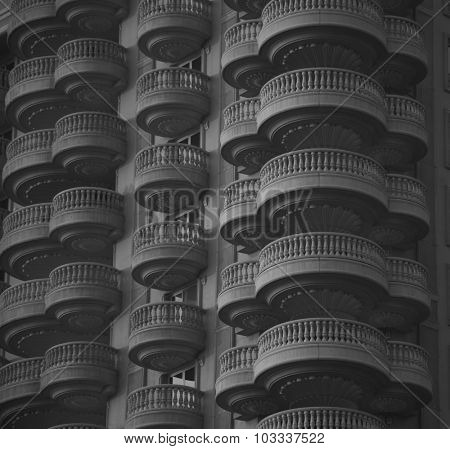 Highly decorative balconies of  a high rise building. View from outside.