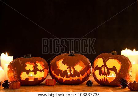 Three Carved Halloween Pumpkin Lanterns