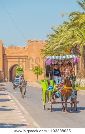 TAROUDANT, MOROCCO, APRIL 9, 2015:Horse drawn carriage near the gate in ancient walls