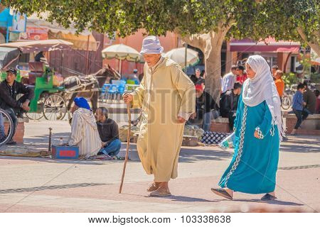 TAROUDANT, MOROCCO, APRIL 9, 2015: Local senior couple in traditional attire walk down the street