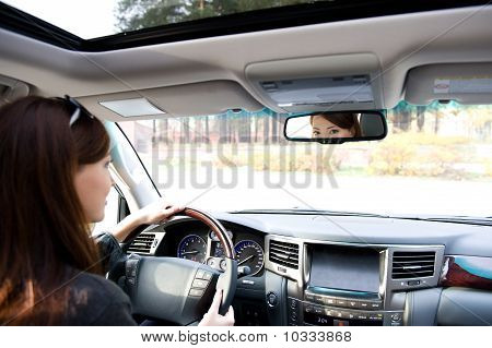 Young Woman Driving  The Car