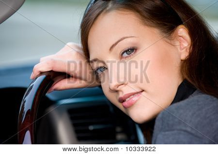 Young Woman In The New Car