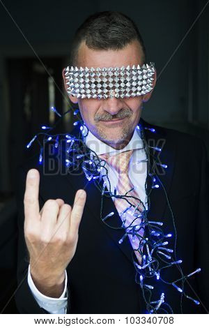 Portrait Of Man In Suit With String Lights And Shiny Glasses