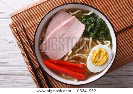 Ramen Noodles In Broth With Pork In A Bowl Close Up. Horizontal Top View