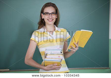 Teacher Infront Of Blackboard