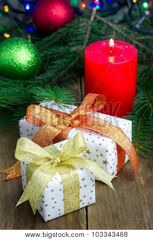 Christmas Composition With Gift Box And Candle, Closeup