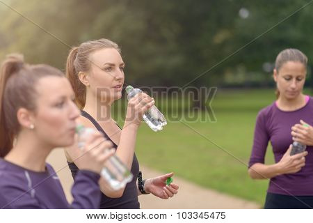 Athletic Women Drinking Water After An Exercise