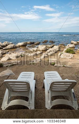Loungers On The Rocky Beach