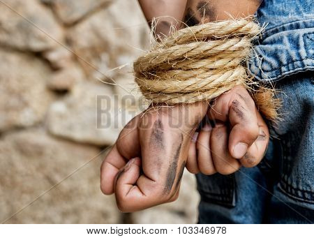 Prisoner bound with rope