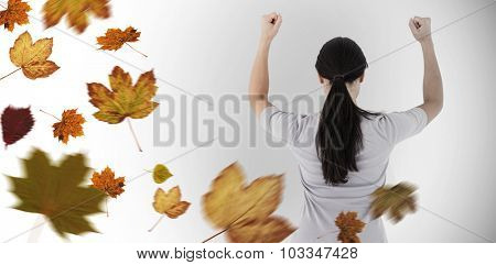 Depressed woman standing back to camera against autumn leaves