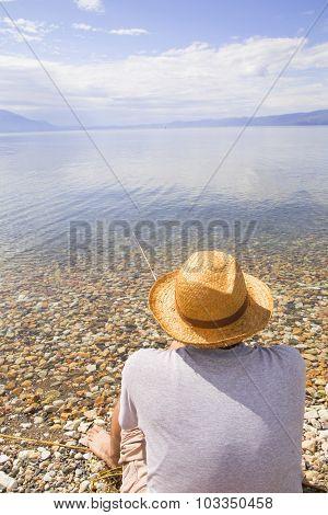 Fisherman Fishing At The Lake