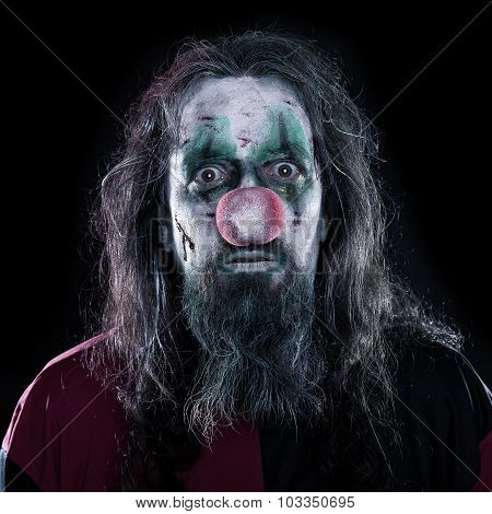 Portrait Of A Creepy Clown In Front Of Black Background, Concept Horror Or Halloween