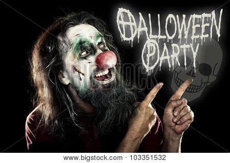 Evil Clown Pointing To The Text Halloween Party, Black Background With A Skull