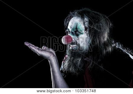 Horror Clown With Ugly Face Looking To Copyspace, Black Background, Concept Halloween Or Theme Party
