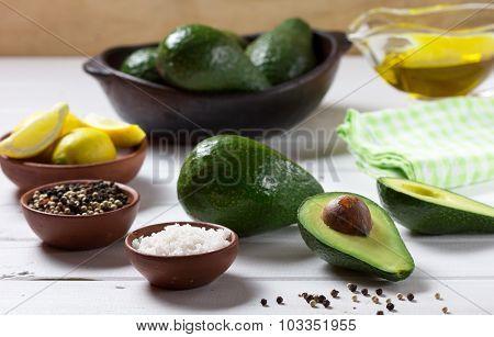 Avocado and ingredients for guacamole. Selective focus