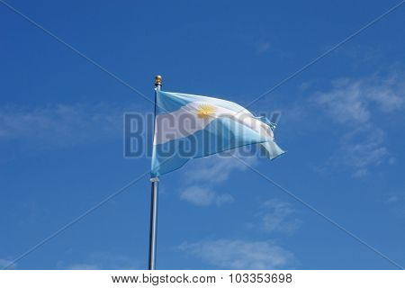 Argentina flag waving in the mast with blue sky background